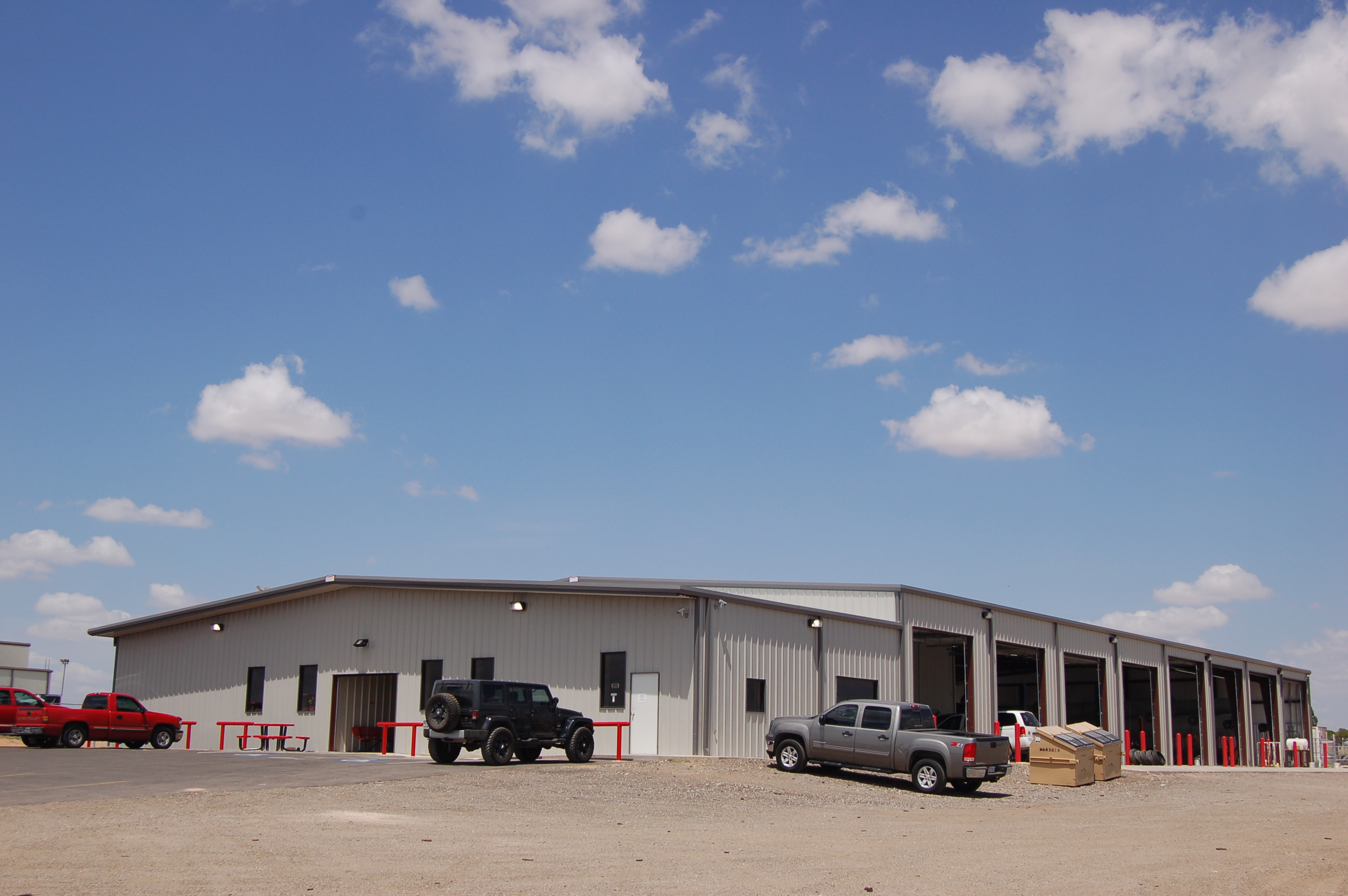 Rigid provides new metal building for don s tire shop in for Building a shop house